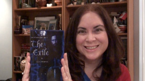 Ms. McIntyre poses with The Exile - Lies of Lesser Gods Book One